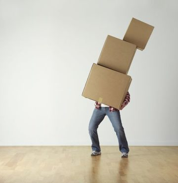 man carrying lots of boxes