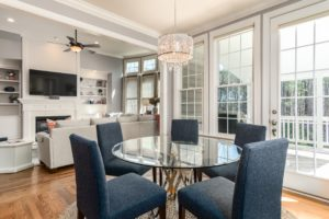dining table with blue chairs and open to kitchen