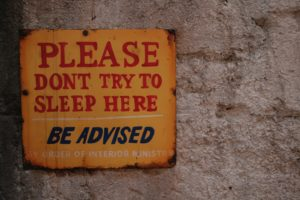 Please Don't Sleep Here sign