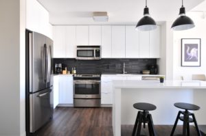 white kitchen, stainless appliances, minimal clutter