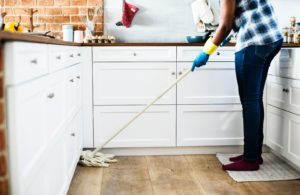 person shown mopping floors