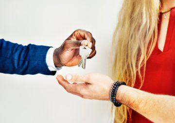 seller handing house keys to buyer