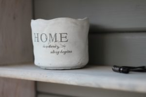 white basket with letters that spell home