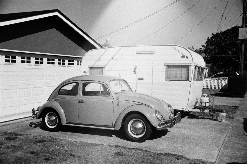 car and camper in driveway