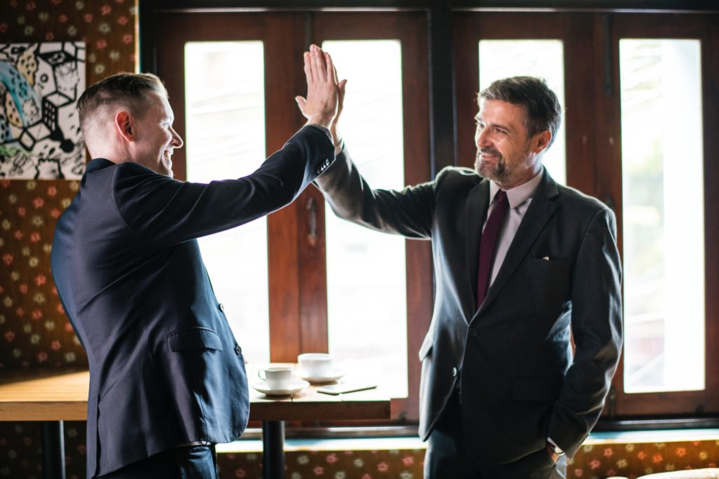 two men giving high fives